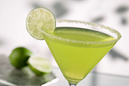 vodka: margarita drink with lime, focus is on rim of glass, and salt Stock Photo