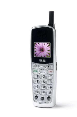 cordless phone on white background, slight shadow,flower on screen photo