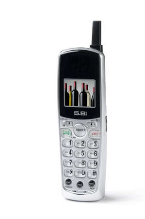 cordless phone: cordless phone on white background, slight shadow, wine bottles on screen