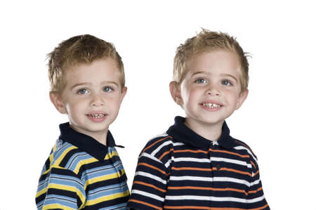 two years: Identical twin boys, they are two years old, white background Stock Photo
