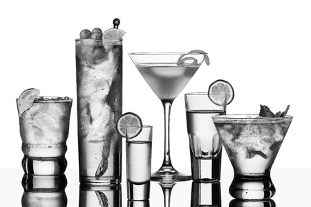 five vodka drinks on glass surface with reflection, white background Stock Photo - 8098037