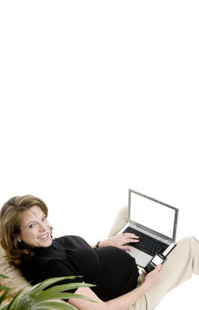 smiling pregnant woman in her 40's, with laptop, and phone, casual clothing, blank screens Stock Photo - 8552323