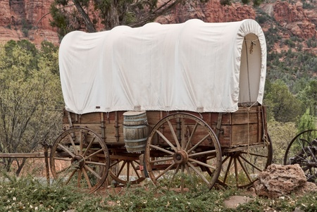covered wagon: Nice old covered wagon in Arizona, red rock background