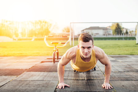 Man do workout at stadium area with sunshine background Stock Photo