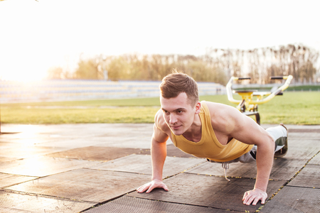 Man do workout at stadium area with sunshine background Stock Photo