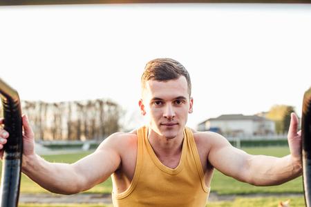 big shirt: Man do workout at stadium area with sunshine background Stock Photo