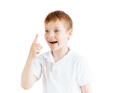 forefinger: Little boy stand on white background and show his emotions Stock Photo