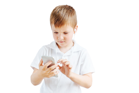 Little boy listen music and talk on phone with white background