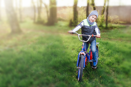 Little boy with bike at park background