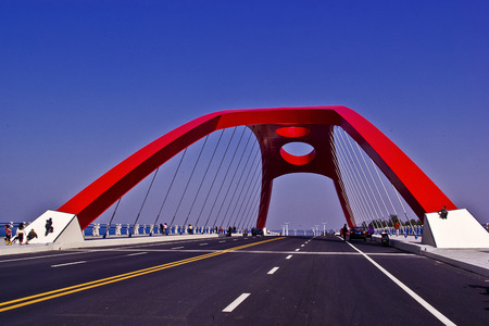 red bridge on the asphalt road Editorial