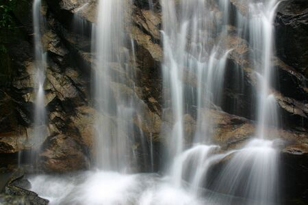 A scenic waterfall stream in silky effect. Stock Photo - 639057
