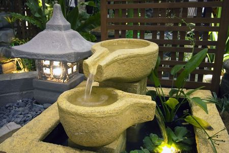 A japanese fountain decoration in the garden.