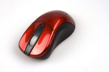 A red wireless computer mouse over white background.