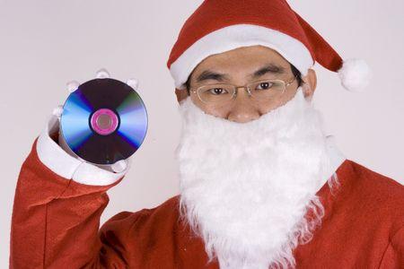 Asian Santa Claus holding a compact disc. photo