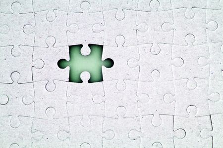 difficult task: A jigsaw puzzle with a missing piece. Stock Photo