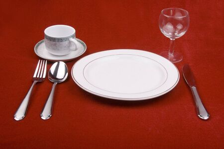 Place setting of a dinning set in red background. Stock Photo - 665837