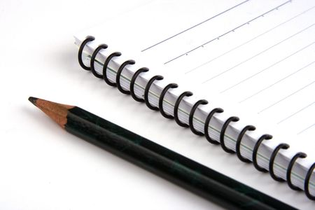 Close up of pencil and note book.
