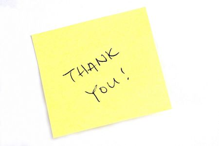 Sticky post it note with Thank You wording. Stock Photo