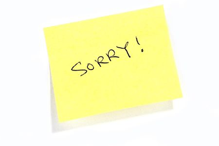 Sticky post it note with Sorry wording.