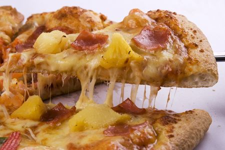 cheesy: A close up view of a cheesy pizza.