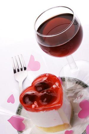 Un vino rosso con amore forma dessert. Archivio Fotografico