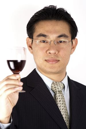 A Chinese businessman holding a red wine.