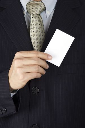 A business man holding a blank business card.