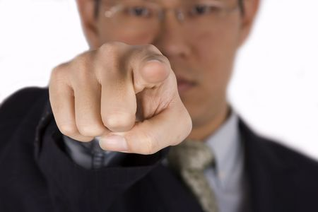 A chinese business man pointing towards camera.