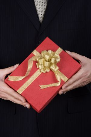 A business man holding a red gift box. photo