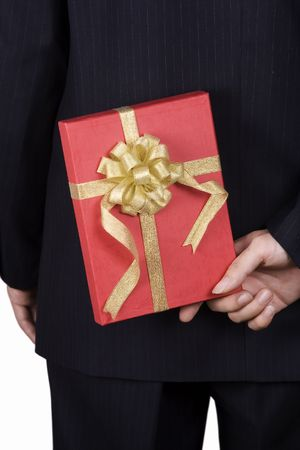 A business man holding a red gift box hiding at the back. photo