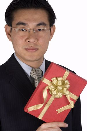 A chinese businessman holding a red present. photo