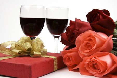 Rose with gift box and red wine. Stock Photo