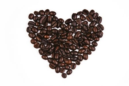 Close up of coffee bean in love shape. Stock Photo