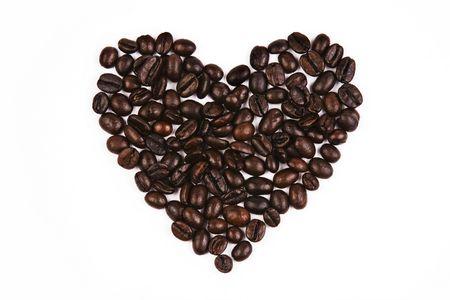 Close-up van de koffieboon in liefde vorm. Stockfoto