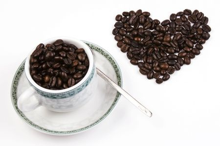 Coffee bean in love shape with cup. photo