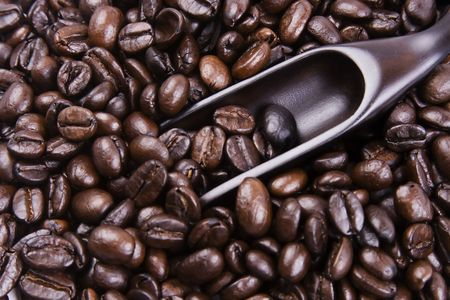 Some coffee bean with a wooden scoop. Stock Photo