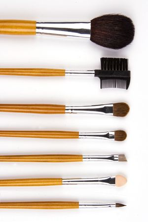 Cosmetic brushes lined up in white background.