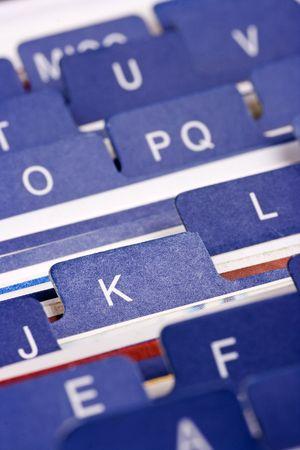 Close up of desktop business card index holder.