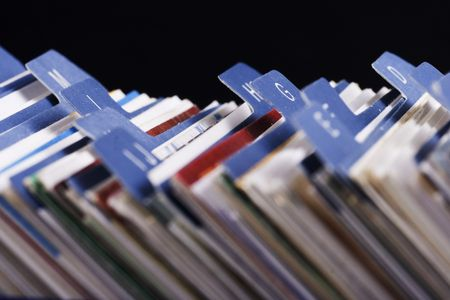 Close up of desktop business card index holder. photo