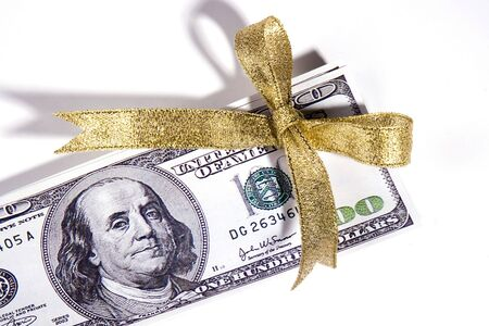 One hundred US dollar bill with bow ribbon. Stock Photo