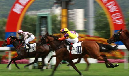 jockey: The Horse Racing at Hong Kong Jockey Club. (got some noise due to high ISO and slight blurry for motion effect)