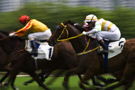 jockey: The Horse Racing at Hong Kong Jockey Club. (got some noise due to high ISO and blurry for motion effect) Stock Photo