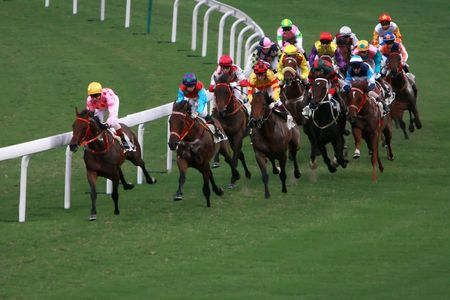 The Horse Racing at Hong Kong Jockey Club. (got some noise due to high ISO and slight blurry for motion effect)