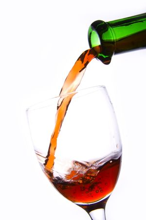 Pouring the red wine into the wineglass in white background. Stock Photo - 2272114
