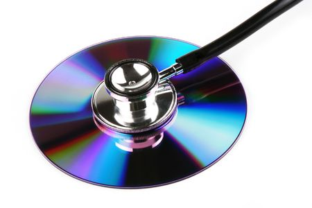 A stethoscope and a compact disk in white background. Stock Photo