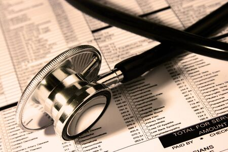 A Stethoscope over a medical report in Sephia color Stock Photo