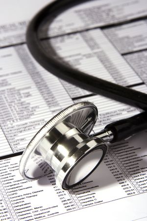 A Stethoscope over a medical report form. photo