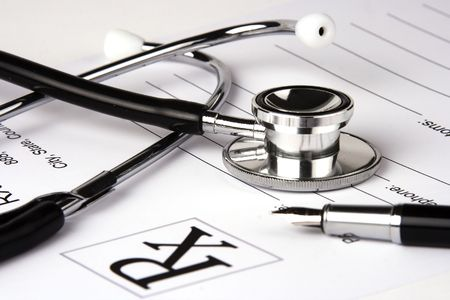 A Stethoscope over a medical report form.