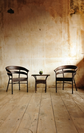 Two chairs against a beige wall