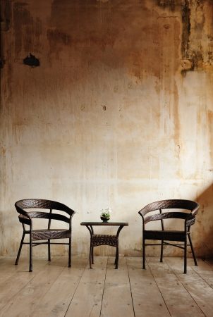 Two chairs against a beige wall photo